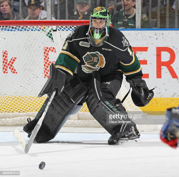 Tyler Parsons ##1 of the London Knights clears a puck against the Kitchener Rangers during an OHL game at Budweiser Gardens on February 1 2017 in...