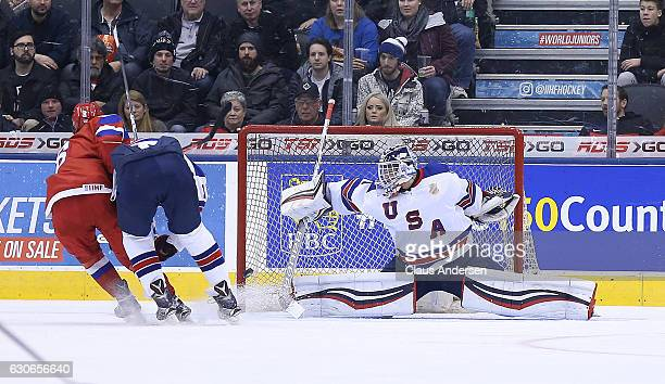 Tyler Parsons of Team USA gets beat by Kirill Urakov of Team Russia during a preliminary game at the 2017 IIHF World Junior Hockey Championship at...