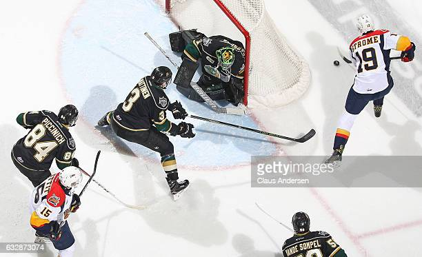 Tyler Parsons of the London Knights covers the corner against Dylan Strome of the Erie Otters during an OHL game at Budweiser Gardens on January 27...