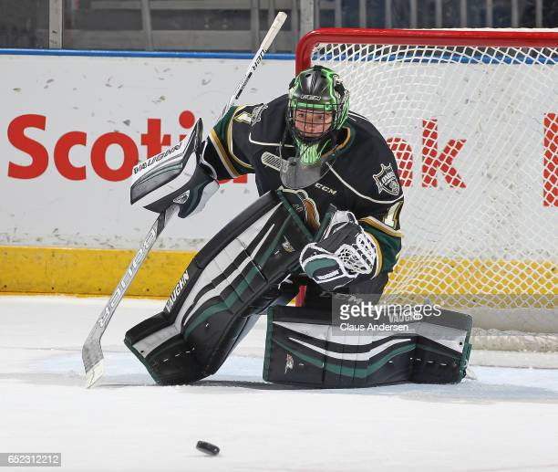 Tyler Parsons of the London Knights looks to stop a puck against the Erie Otters during an OHL game at Budweiser Gardens on March 10 2017 in London...