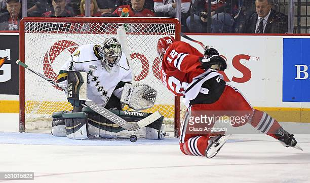 Tyler Parsons of the London Knights stops a point blank scoring attempt by Stephen Harper of the Niagara IceDogs during Game Four of the OHL...