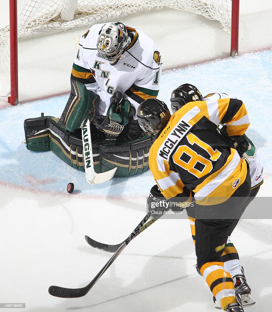 Tyler Parsons #1 of the London Knights stops a scoring attempt by Conor McGlynn #81 of the Kingston Frontenacs in an OHL game at Budweiser Gardens on November 29, 2014 in London, Ontario, Canada. The Frontenacs defeated the Knights 3-2 in an overtime shoot-out.