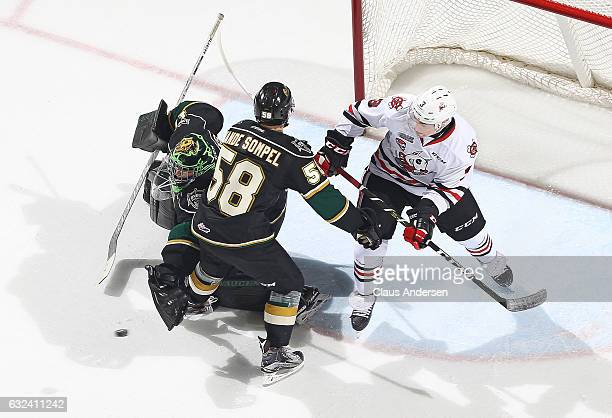 Tyler Parsons of the London Knights stops a shot against the Niagara IceDogs during an OHL game at Budweiser Gardens on January 22 2017 in London...