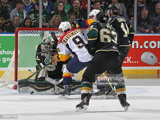 Tyler Parsons of the London Knights stops a shot from Kyle Maksimovich of the Erie Otters during game four of the OHL Western Conference Final on...