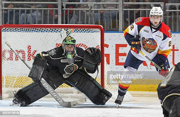 Tyler Parsons of the London Knights waits to face a shot with Anthony Cirelli of the Erie Otters on his doorstep during an OHL game at Budweiser...