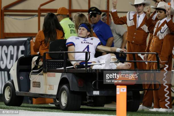 Tyler Patrick of the Kansas Jayhawks is carted off the field in the second half against the Texas Longhorns at Darrell K RoyalTexas Memorial Stadium...