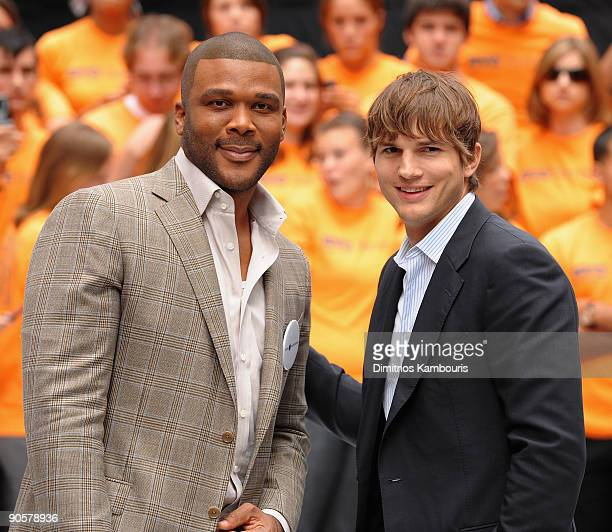 Tyler Perry and Ashton Kutcher attend the Entertainment Industry Foundation's volunteer initiatives kick off in Duffy Square on September 10 2009 in...