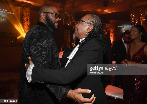 Tyler Perry and Ms Gloria Carter attend the Shawn Carter Foundation Gala at Hard Rock Live in the Seminole Hard Rock Hotel Casino on November 16 2019...