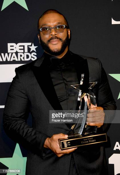 Tyler Perry poses in the press room at the 2019 BET Awards on June 23 2019 in Los Angeles California