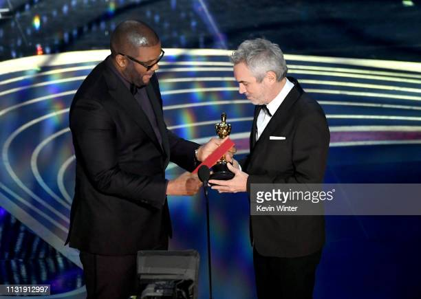 Tyler Perry presents the Cinematography award for 'Roma' to Alfonso Cuaron onstage during the 91st Annual Academy Awards at Dolby Theatre on February...