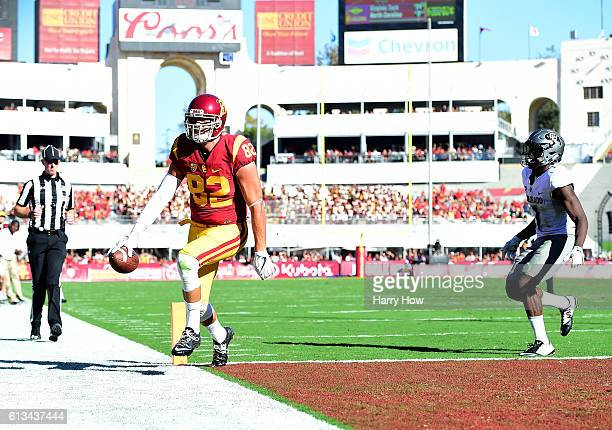 Tyler Petite of the USC Trojans reacts as he scores a touchdown in front of Afolabi Laguda of the Colorado Buffaloes to take a 2114 lead during the...