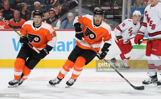 Tyler Pitlick and Carsen Twarynski of the Philadelphia Flyers skate against the Carolina Hurricanes on November 5, 2019 at the Wells Fargo Center in...
