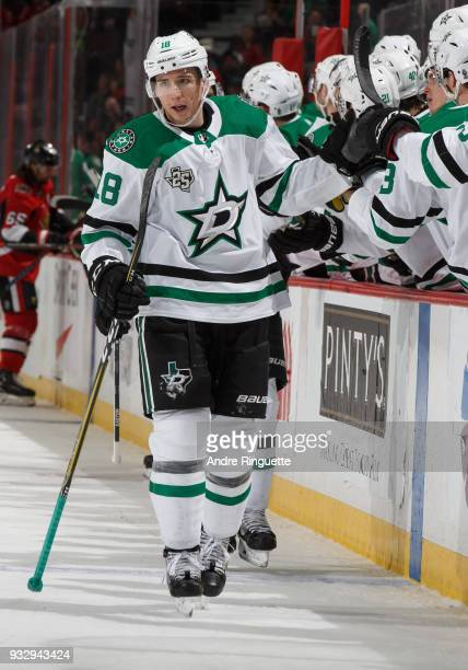 Tyler Pitlick of the Dallas Stars celebrates his third period goal against the Ottawa Senators with teammates at the players bench at Canadian Tire...