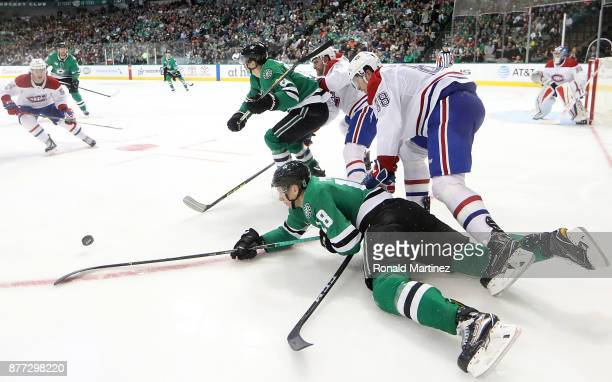 Tyler Pitlick of the Dallas Stars skates for the puck against Brandon Davidson of the Montreal Canadiens in the third period at American Airlines...