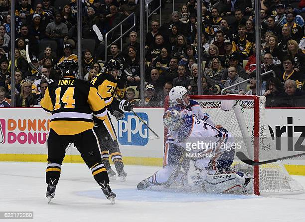 Tyler Pitlick of the Edmonton Oilers crashes into his goaltender Cam Talbot after Evgeni Malkin of the Pittsburgh Penguins scores a goal at PPG...
