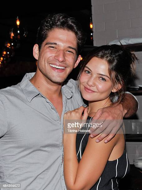 Tyler Posey and Danielle Campbell attend Cameron Monaghan's birthday dinner at The District by Hannah An on August 15 2015 in Los Angeles California