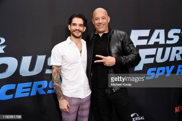 Tyler Posey and Vin Diesel attend Fast Furious Spy Racers World Premiere at Universal CityWalk on December 07 2019 in Universal City California