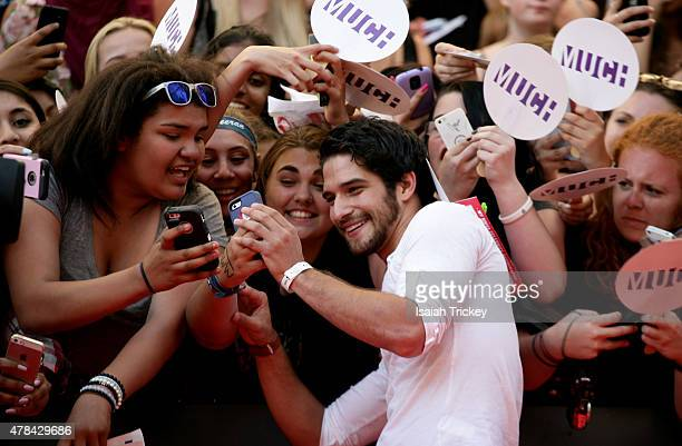 Tyler Posey arrives at the 2015 MuchMusic Video Awards at MuchMusic HQ on June 21 2015 in Toronto Canada