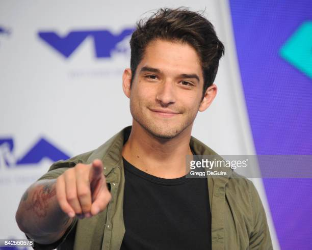 Tyler Posey arrives at the 2017 MTV Video Music Awards at The Forum on August 27 2017 in Inglewood California