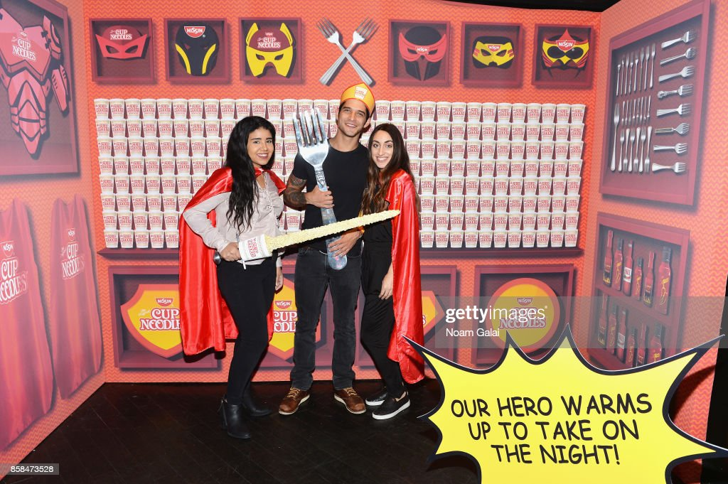 Tyler Posey (C) poses with fans during the Nissin Cup Noodles event at Highline Ballroom on October 6, 2017 in New York City. Twenty lucky Nissin Cup Noodles fans were given access to the New York Comic Con Heroes After Dark party and the exclusive Noods Before Dark pre-party hosted by New York Comic Con fan favorite and Cup Noodles enthusiast Tyler Posey. Fans who won the coveted tickets had the opportunity to hang out with Posey at the invite only pre-party and slurp on instant ramen before the doors of the Highline Ballroom opened up to other attendees.
