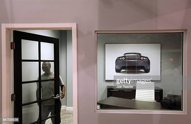 Tyler puts finishing touches on an office at the Tesla Motors first South Florida location on December 17 2009 in Dania Beach Florida Tesla produces...