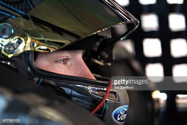 Tyler Reddick driver of the BBR Music Group Ford sits in his truck during practice for the NASCAR Camping World Truck Series American Ethanol 200 at...