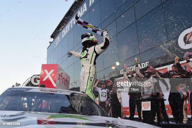 Tyler Reddick driver of the BurgerFi Chevrolet celebrates in Victory Lane after winning the NASCAR Xfinity Series PowerShares QQQ 300 at Daytona...