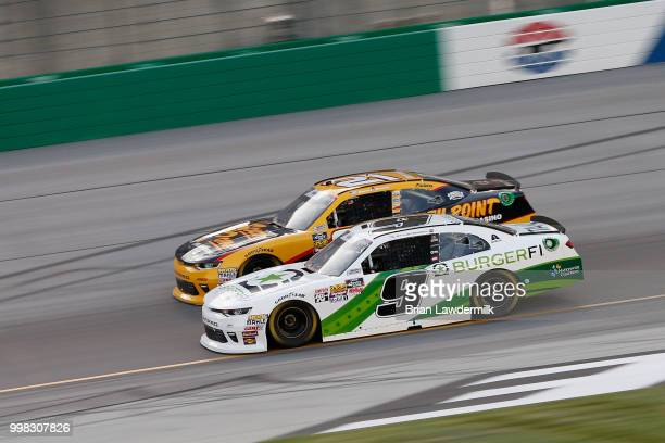 Tyler Reddick driver of the BurgerFi Chevrolet leads Daniel Hemric driver of the South Point Hotel Casino Chevrolet during the NASCAR Xfinity Series...