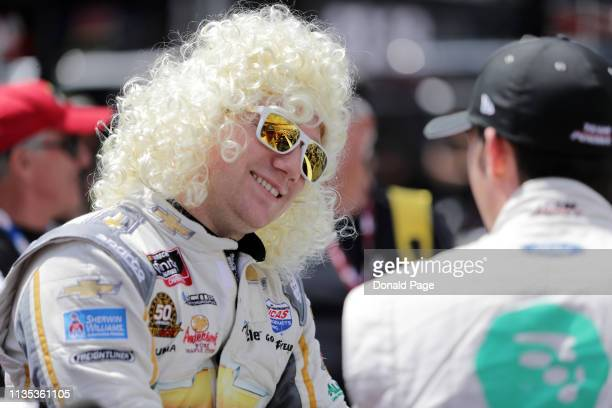 Tyler Reddick driver of the Dolly Parton Chevrolet speaks with Austin Cindric driver of the MoneyLion Ford on the grid prior to the NASCAR Xfinity...