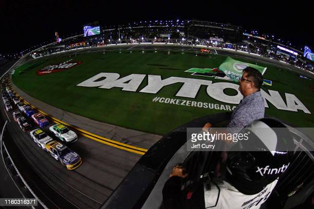Tyler Reddick driver of the Gimme Country Chevrolet takes the green flag to start the NASCAR Xfinity Series Circle K Firecracker 250 Powered by...