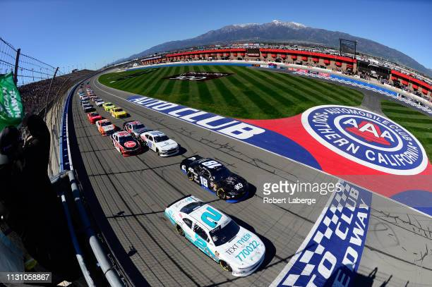 Tyler Reddick driver of the Hurdl Chevrolet and Kyle Busch driver of the iK9 Toyota lead the field to the green flag to start the NASCAR Xfinity...