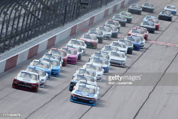 Tyler Reddick driver of the myblu Chevrolet leads the field during a restart for the NASCAR Xfinity Series Sport Clips Haircuts VFW 200 at Darlington...