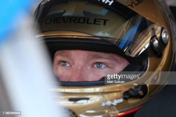Tyler Reddick, driver of the myblu Chevrolet, sits in his car during practice for the NASCAR Xfinity Series Desert Diamond Casino West Valley 200 at...
