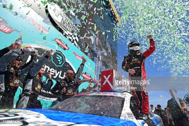 Tyler Reddick driver of the Roland Chevrolet celebrates in Victory Lane after winning the NASCAR Xfinity Series MoneyLion 300 at Talladega...