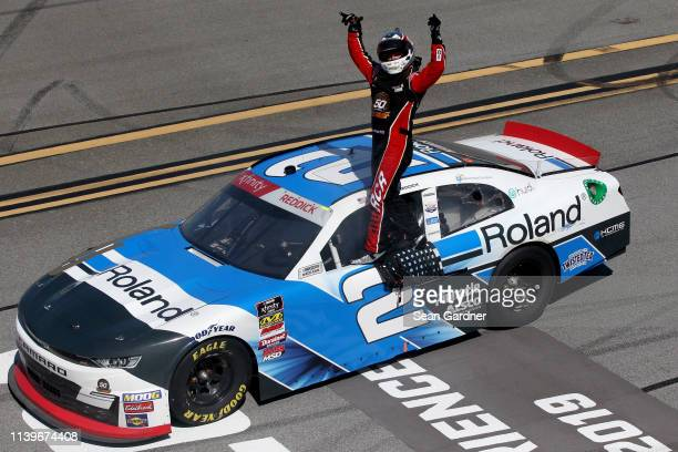 Tyler Reddick driver of the Roland Chevrolet celebrates winning the NASCAR Xfinity Series MoneyLion 300 at Talladega Superspeedway on April 27 2019...