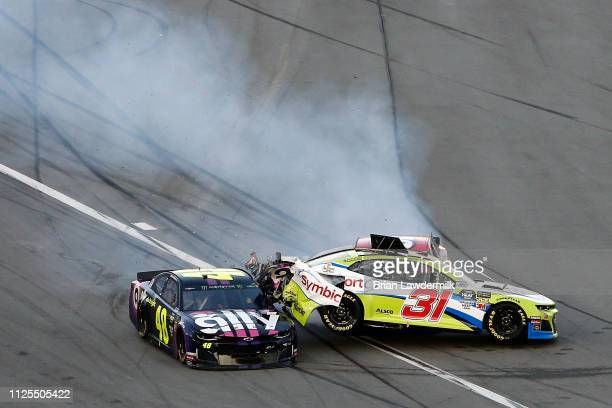 Tyler Reddick driver of the Symbicort Chevrolet and Jimmie Johnson driver of the Ally Chevrolet are involved in an ontrack incident during the...