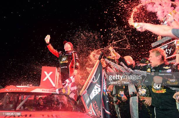 Tyler Reddick driver of the Tame the Beast Chevrolet celebrates in Victory Lane after winning the NASCAR Xfinity Series Ford EcoBoost 300 and the...