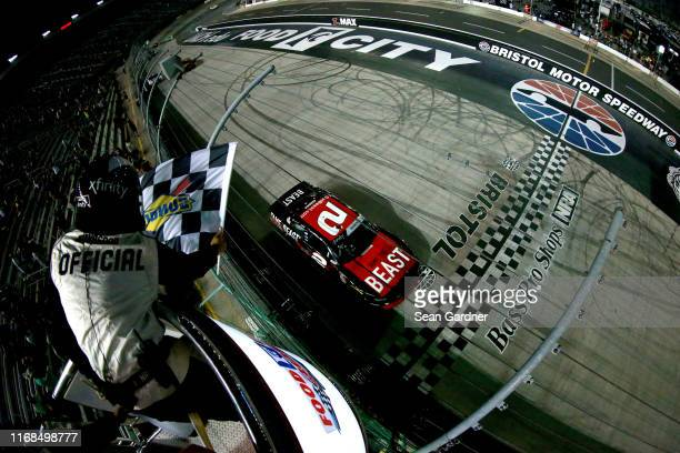 Tyler Reddick driver of the Tame the BEAST Chevrolet takes the checkered flag to win the NASCAR Xfinity Series Food City 300 at Bristol Motor...