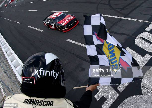 Tyler Reddick driver of the TAME the BEAST Chevrolet wins the NASCAR Xfinity Series Alsco 300 at Charlotte Motor Speedway on May 25 2019 in Charlotte...