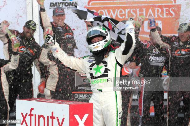 Tyler Reddick JR Motorsports BurgerFi Chevrolet Camaro celebrates winning the Powershares QQQ 300 NASCAR Xfinity Series race on February 17 at the...