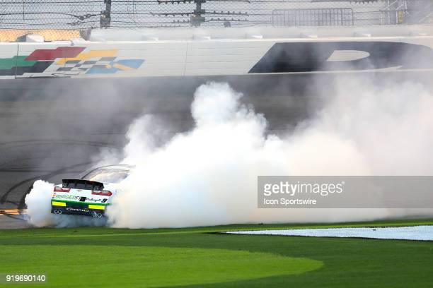 Tyler Reddick JR Motorsports BurgerFi Chevrolet Camaro does a burnout after winning the Powershares QQQ 300 NASCAR Xfinity Series race on February 17...