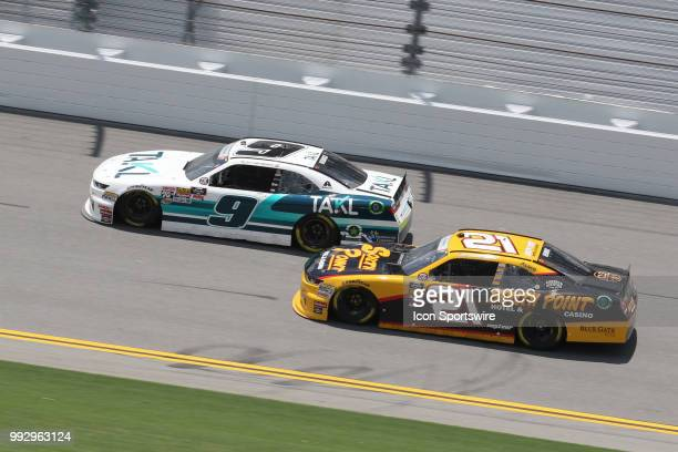 Tyler Redick and Daniel Hemric on the front stretch during practice for the CocaCola FireCracker 250 race on July 5 at Daytona International Speedway...