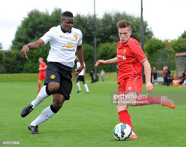 Tyler Reid of Manchester United and Ryan Kent of Liverpool in action during the Barclays Premier League Under 18 fixture between Liverpool and...