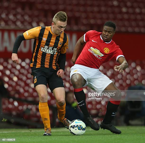 Tyler Reid of Manchester United U18s in action with Jarrod Bowen of Hull City U18s during the FA Youth Cup Fourth Round match between Manchester...