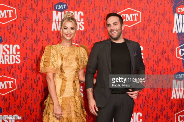 Tyler Rich and Sabina Gadecki attend the 2019 CMT Music Awards at the Bridgestone Arena in Nashville Tennessee