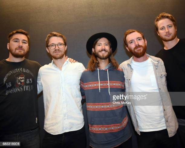 Tyler Ritter Spencer Thomson Trevor Terndrup Tommy Putnam and Wes Bailey of Moon Taxi pose backstage before their performance at Shaky Knees Music...