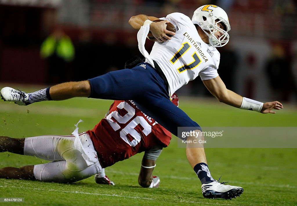Tyler Roberson #17 of the Chattanooga Mocs is tackled by Marlon Humphrey #26 of the Alabama Crimson Tide at Bryant-Denny Stadium on November 19, 2016 in Tuscaloosa, Alabama.