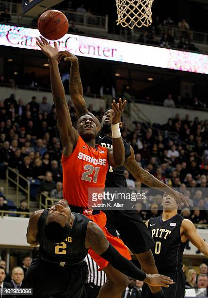 Tyler Roberson of the Syracuse Orange drives to the basket against Michael Young of the Pittsburgh Panthers during the game at Petersen Events Center...
