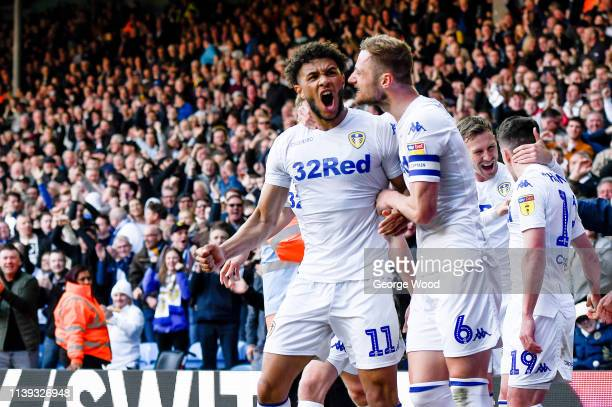 Tyler Roberts and Liam Cooper of Leeds United celebrate after Pablo Hernandez scored their sides third goal to make score 32 during the Sky Bet...