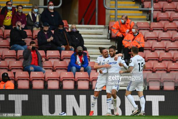 Tyler Roberts of Leeds United celebrates after scoring their sides second goal with team mates Luke Ayling and Stuart Dallas during the Premier...